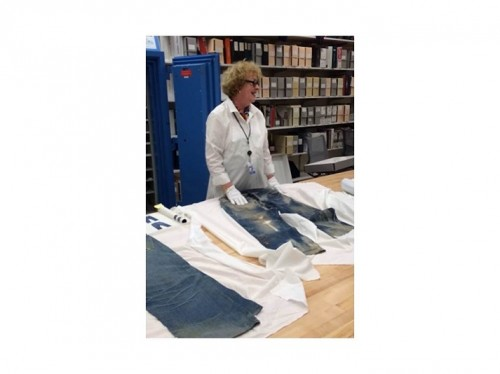 LS&Co. Archivist, Stacia Fink, shows Fashion Law Bootcamp participants the oldest pair of jeans in the LS&Co. archives.