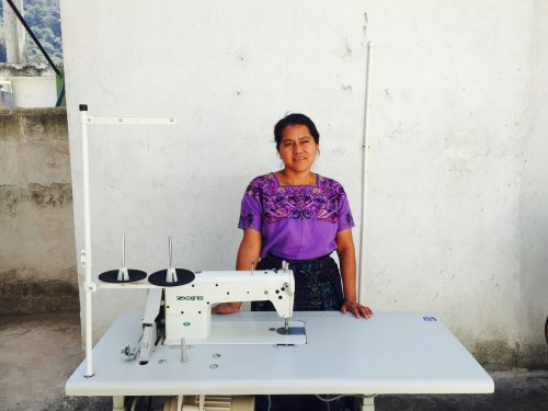 A Mercado Global artisan with her first sewing machine.