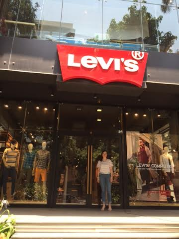 Standing beneath our logo at India's flagship store on Linking Road, Mumbai.